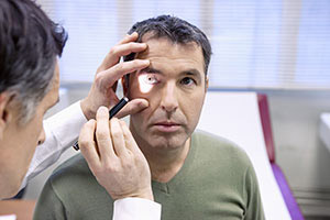 man getting routine eye exam